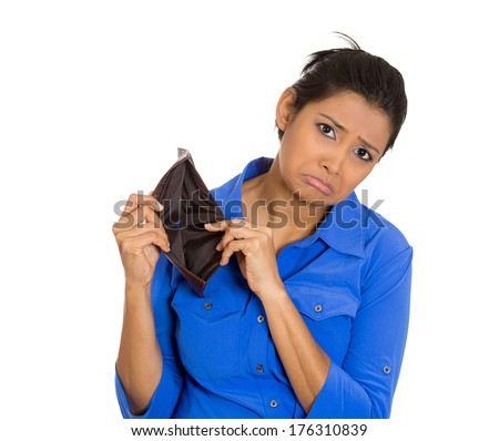 Closeup portrait of shocked, upset, sad, unhappy young woman standing showing empty brown wallet, isolated against white background. Financial difficulties, bad economy concept. Negative emotion - stock photo