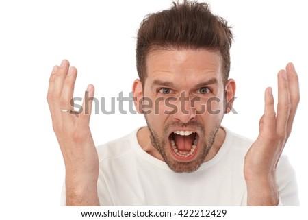 Closeup portrait of shouting young man. - stock photo