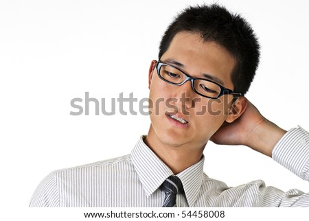 Closeup portrait of shy young business man against white with copyspace.