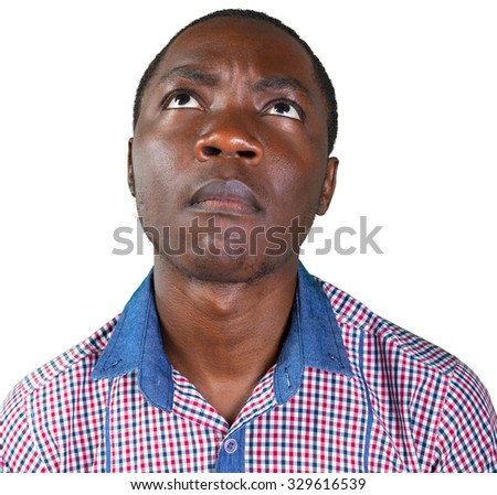 Closeup portrait of skeptical young man looking suspicious - stock photo