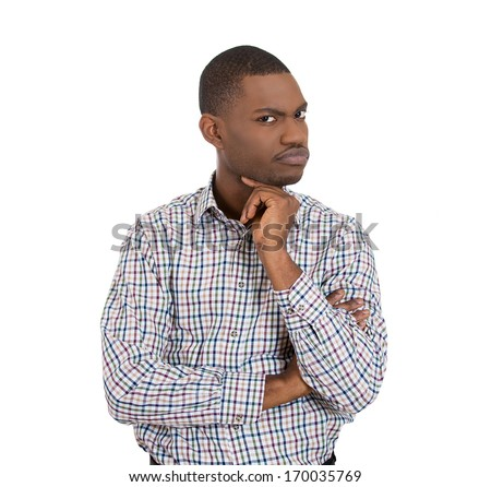 Closeup portrait of skeptical young man looking suspicious and some disgust on his face, mixed with disapproval, isolated on white background. Negative human emotion, facial expressions, feelings - stock photo