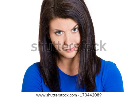Closeup portrait of skeptical young woman looking suspicious with some disgust on her face, mixed with disapproval, isolated on white background. Negative human emotions, facial expressions, feelings - stock photo