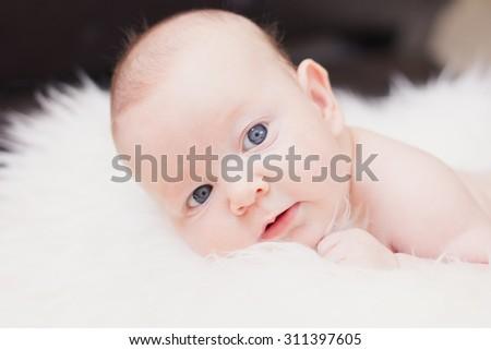 Closeup portrait of sleeping newborn baby boy - stock photo