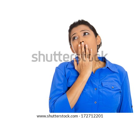 Closeup portrait of sleepy young woman, student placing hand on mouth yawning, looking upwards, isolated on white background. Negative human emotions, facial expressions, feelings, signs and symbols