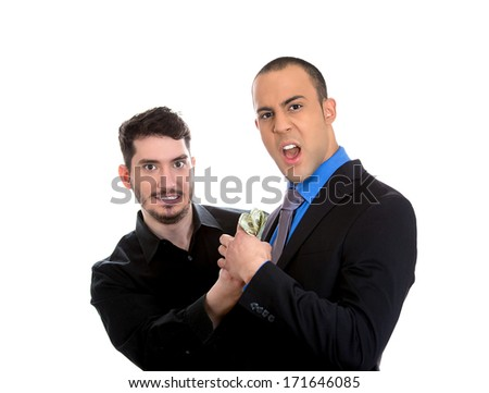 Closeup portrait of sly agent happily stealing money from a shocked and surprised business man, isolated on white background. Financial greed concept. Is your broker taking too much money? - stock photo