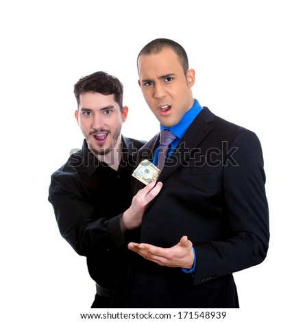 Closeup portrait of sly agent happily stealing money from shocked, surprised business man, worker, isolated on white background. Financial greed concept. Is your broker taking too much money?  - stock photo