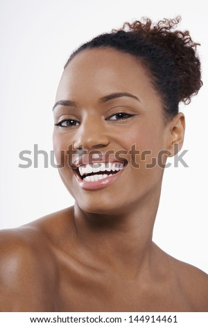 Closeup portrait of smiling African American woman with perfect skin isolated on white background - stock photo