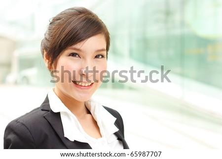 Closeup portrait of smiling business woman - stock photo