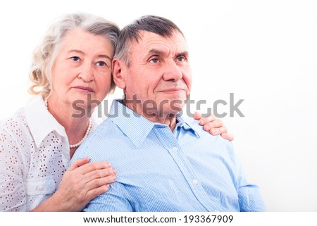 Closeup portrait of smiling elderly couple isolated. Old people holding hands. Concept of marital fidelity, providing for old age, reliability, care for the elderly, love confession  - stock photo
