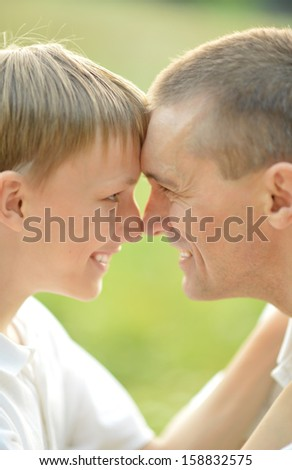 Closeup portrait of smiling father and his son - stock photo