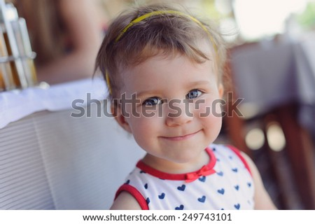 closeup portrait of smiling girl with gray eyes