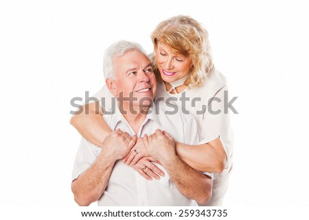 Closeup portrait of smiling happy elderly couple. Isolated on white background. - stock photo