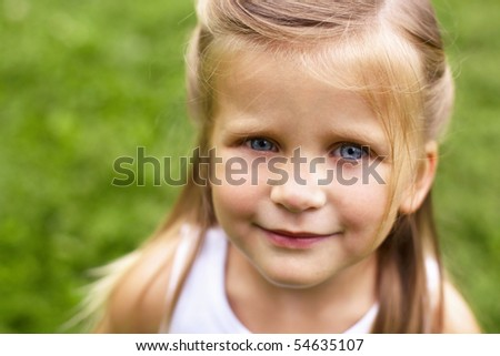 closeup portrait of smiling little girl outdoor - stock photo