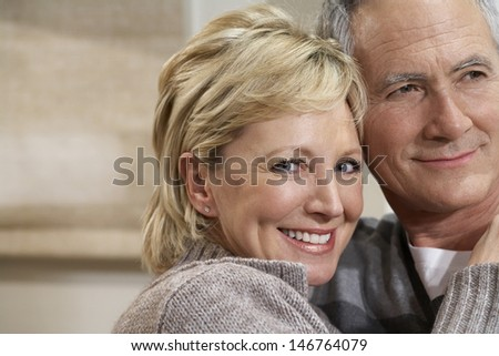 Closeup portrait of smiling middle aged woman embracing man - stock photo