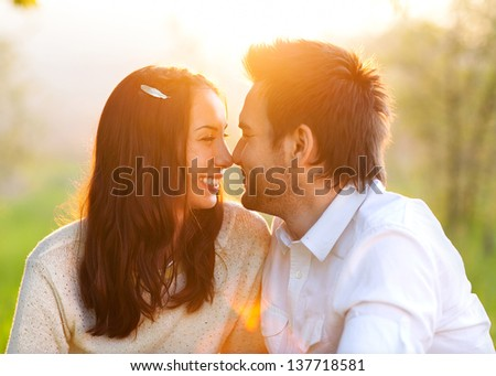 Closeup portrait of smiling young couple in love - Outdoors - stock photo
