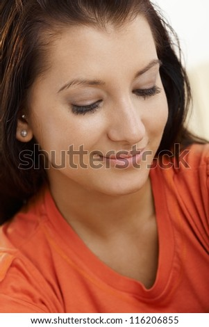 Closeup portrait of smiling young girl. - stock photo