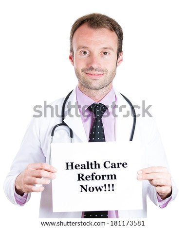 Closeup portrait of smiling young health care professional, doctor, nurse, with stethoscope holding health care reform now! sign, isolated on white background. Government, politics, insurance, debate - stock photo