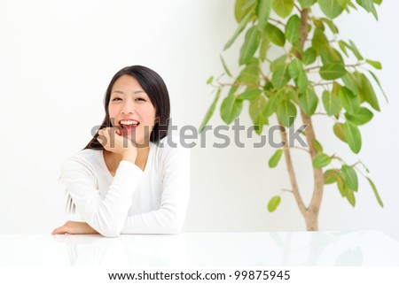 Closeup portrait of smiling young woman - stock photo