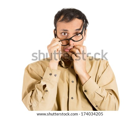 Closeup portrait of stressed, anxious, overwhelmed young man, student, teacher, worker, employee, looking completely lost, holding his glasses, can't believe bad news he just received. Human emotions - stock photo
