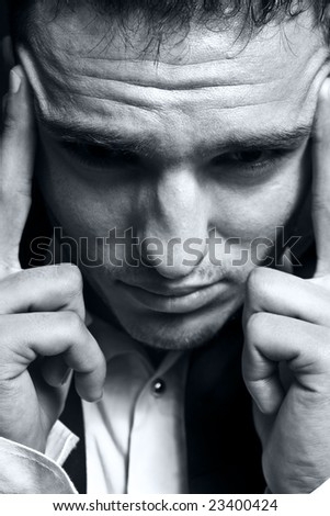 Closeup portrait of stressed businessman with headache - stock photo