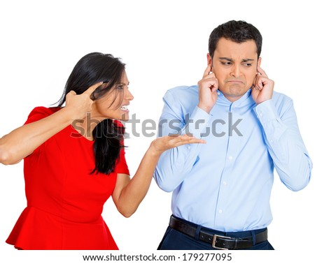 Closeup portrait of stressed couple going through hard times in relationship, isolated on white background . Young woman yelling screaming shouting at man, he is annoyed and ignores closes plugs ears. - stock photo