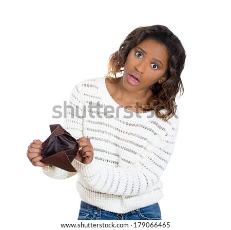 Closeup portrait of stressed, upset, sad, unhappy, shocked young woman standing with, showing empty wallet, isolated on white background. Financial difficulties, bad economy concept. Negative emotions - stock photo
