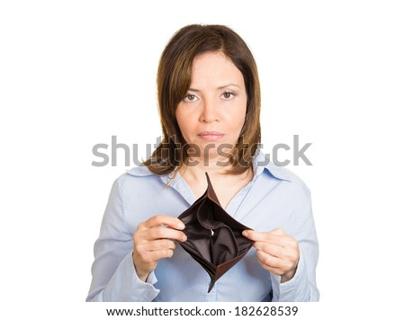 Closeup portrait of stressed, upset, sad, unhappy young woman standing showing empty brown wallet, isolated against white background. Financial difficulties, bad economy concept. Negative emotion - stock photo