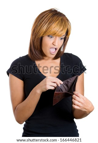 Closeup portrait of stressed, upset, sad, unhappy young woman standing with, looking into empty wallet, isolated against white background. Financial difficulties, bad economy concept. Negative emotion - stock photo