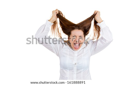 Closeup portrait of stressed woman pulling her hair out, yelling and screaming with a temper tantrum, isolated on white background with copy space. Negative human emotion facial expressions - stock photo