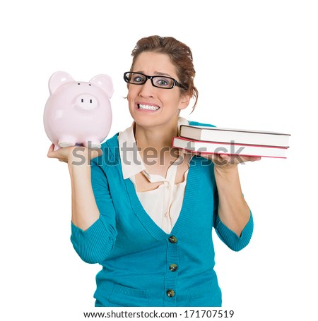 Closeup portrait of stressed woman with big black glasses balancing piggy bank in one hand and books in another. Student having trouble paying for academic college education degree tuition concept - stock photo