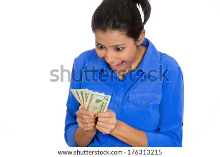 Closeup portrait of super happy excited successful business woman, funny looking face holding money dollar bills in hand, isolated white background. Positive human emotions, facial expression feeling. - stock photo