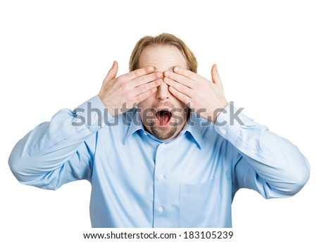 Closeup portrait of surprised, coy man closing eyes with hands can't see and hiding mouth wide open, isolated on white background. See no evil concept. Negative emotion facial expression feelings - stock photo