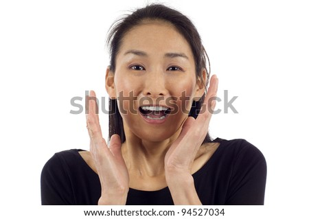 Closeup portrait of surprised young Asian woman isolated over white background