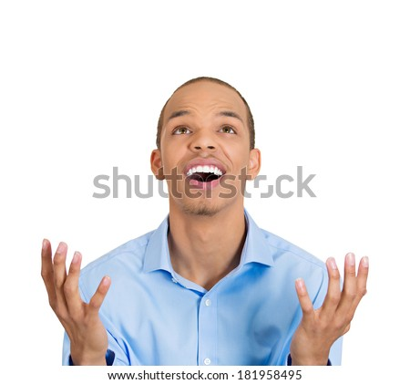 Closeup portrait of surprised young happy funny looking man, just came up with idea aha, looking up, hands in air, isolated white background. Positive human emotion, facial expression, feeling, sign
