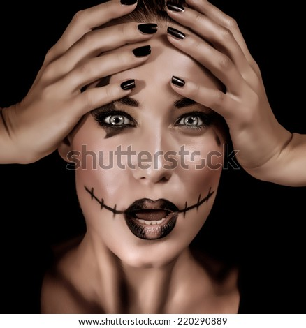 Closeup portrait of terrifying witch with spooky painted face and open mouth isolated on black background, Halloween holiday concept - stock photo