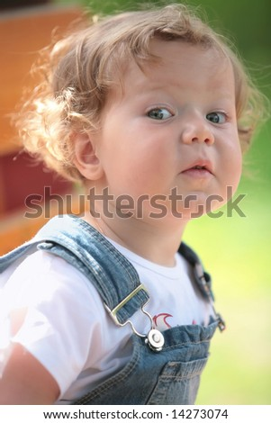 closeup portrait of the beautiful little blonde - stock photo