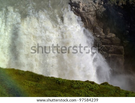 Closeup portrait of the Gullfoss (Golden falls) waterfall and rainbow in Iceland - stock photo