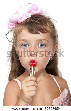 closeup portrait of the little girl with lipstick - stock photo