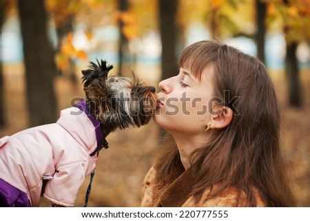 Closeup portrait of the smiling girl of the disabled person and her dog, look at each other - stock photo