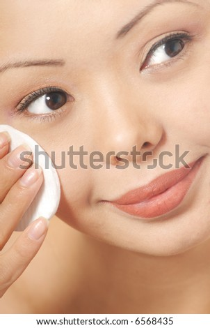 Closeup portrait of the woman with smooth skin and sponge - stock photo
