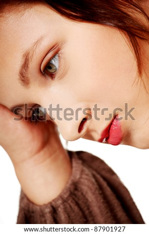 Closeup portrait of thinking caucasian woman over white background. - stock photo