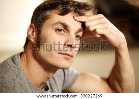 Closeup portrait of thinking man, looking away, hand on forehead. - stock photo