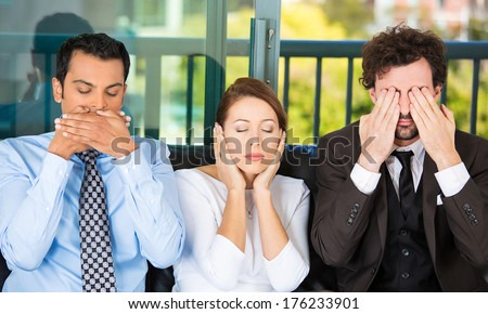 Closeup portrait of three business people on black couch imitating see no evil, hear no evil, speak no evil concept, isolated on city urban background. Human emotions, expressions and communication - stock photo