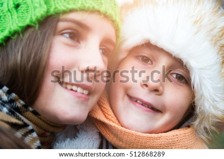 Closeup portrait of two happy little sisters in autumn day