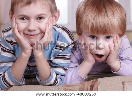 closeup portrait of two little boys - stock photo