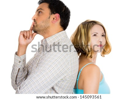 Closeup portrait of two people or couple back to back thinking deeply about something, isolated on white background - stock photo