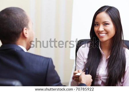 Closeup portrait of two successful business executive exchanging business card - stock photo