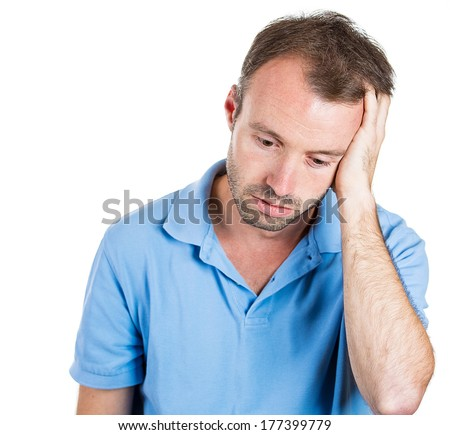 Closeup portrait of unhappy guy, sad thoughtful young business man thinking, daydreaming deeply, bothered by mistakes, hand on head looking downwards, isolated on white background. Negative emotions - stock photo