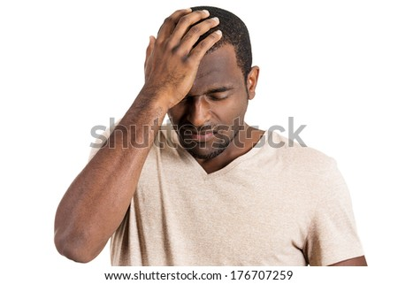 Closeup portrait of unhappy guy, sad thoughtful young business man thinking deeply, bothered by mistakes, hand on head looking downwards, having headache isolated on white background. Negative emotion - stock photo