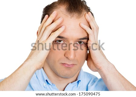 Closeup portrait of unhappy sorry guy, sad thoughtful young business man thinking, daydreaming deeply, bothered by mistakes, hand on head through you, isolated on white background. Negative emotions - stock photo